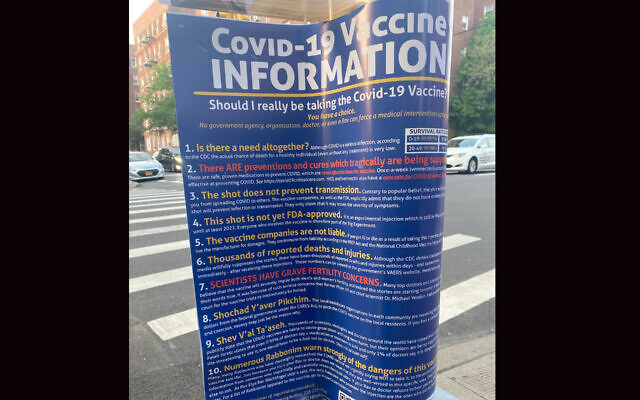 Flyers discouraging people from taking the COVID vaccines were posted last week in Midwood, a heavily Orthodox Jewish neighborhood in Brooklyn. (Luis Hernandez/JTA)