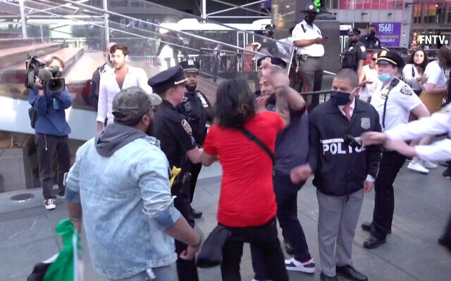 Video footage shows scuffles between pro-Israel and pro-Palestinian demonstrators in Times Square Thursday afternoon, as Israel and Hamas declared a ceasefire after 11 days of fighting. (Via Twitter)