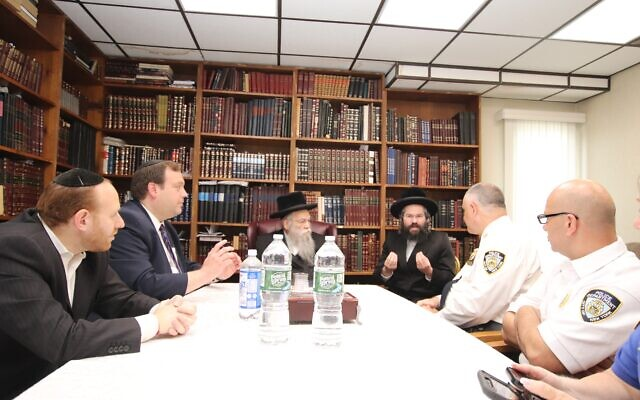SAFETY FIRST: NYPD brass met with Jewish leaders at the Grossvardein Shul in Staten Island to discuss  antisemitism and the security needs of the Jewish Community, June 1, 2021. Around the table, left to right, Ari Weiss, chairman, Council of Jewish Organizations of Staten Island Security Committee, and coordinator, Staten Island Shomrim; Mendy Mirocznik, president, COJO; Rabbi Tzvi Pollack, the Grossvardein Rav; Rabbi Chaim Yehuda Pollack, Rosh Kollel, Willowbrook Community Kollel; Chief Frank Vega, NYPD, Staten Island Borough commander; and Lt. Rafet Awad, commanding officer, Patrol Borough Staten Island. (Courtesy)
