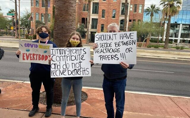Members of Arizona Jews For Justice and Arizona Dream Act Coalition met outside the Attorney General's office to protest public charge rules that prevent immigrants receiving public benefits, March 12, 2021.(Arizona Jews For Justice)