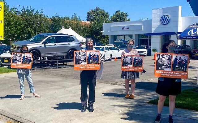 Jewish World Watch demonstrators in front of a Volkswagen dealership in Los Angeles defend Uyghur human rights and denounce the company's factory in Xinjiang. (Courtesy Jewish World Watch)