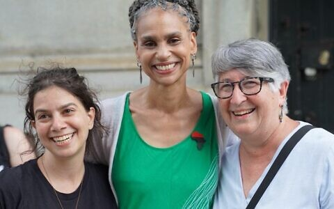 Mayoral candidate Maya Wiley, center, with Audrey Sasson, executive director of Jews for Racial and Economic Justice, left, and Rabbi Ellen Lippmann, at an event in Brooklyn's Grand Army Plaza marking the end of Shabbat, June 19, 2021. (Courtesy JFREJ) .
