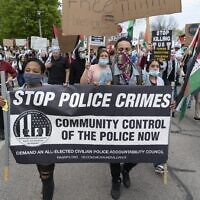 """At a pro-Palestinian march in Milwaukee's Bradford Beach, protesters conflate the movement to end police brutality with calls to """"free Palestine,"""" May 18, 2021. (Joe Brusky/Flickr Commons)"""