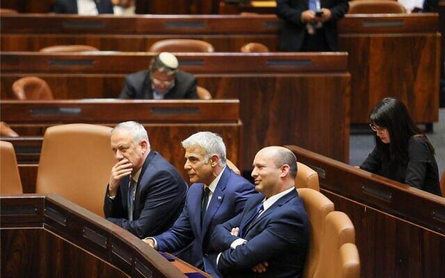 Listening to Sunday's Knesset debate are members of Israel's new government, from left, Defense Minister Benny Gantz, Alternate Prime Minister and Foreign Minister Yair Lapid, and Prime Minister Naftali Bennett, June 13, 2021. (Knesset.gov.il)