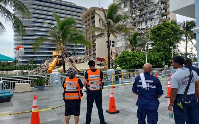 WATCHING AND WAITING: Members of United Hatzalah, Israel's national community-based volunteer EMS organization, on the scene of the building collapse in Surfside, Florida, June 28, 2021. Rescue crews continue to search through the rubble for survivors. (Courtesy United Hatzalah)