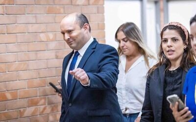 Yemina leader Naftali Bennett on his way to announce in a press conference at the Knesset that he will join centrist Yair Lapid's coalition, May 30, 2021. (Yonatan Sindel/Flash90)