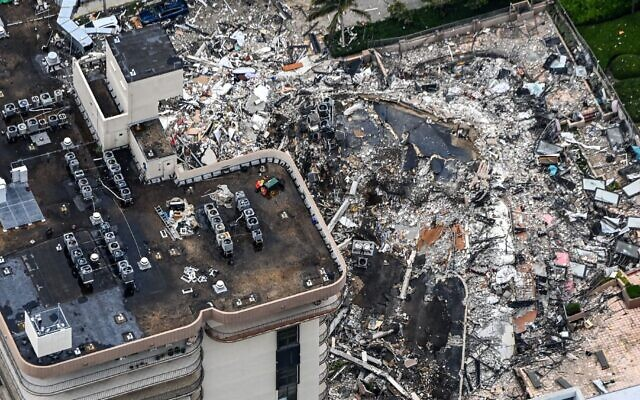 Search and rescue personnel working on site after the partial collapse of the Champlain Towers South in Surfside, Florida on June 24, 2021. (Chandan Khanna/AFP via Getty Images)