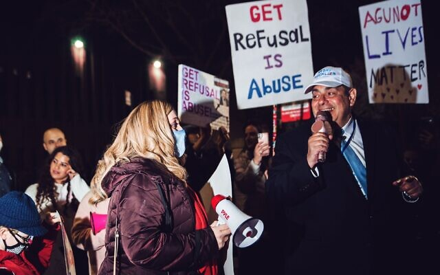 Amber Adler, left, and Heshy Tischler, candidates for New York's City Council, attend a rally in Brooklyn on March 21, 2021. The rally was part of a movement to free a woman whose husband refused to grant her a divorce. (Anna Rathkopf)