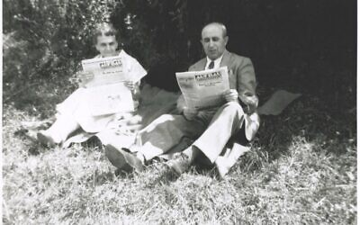 """In 1953, a Washington Heights couple reads the Aufbau, a German-language Jewish newspaper published in New York until 2004. """"In the Heights,"""" a new movie musical about the neighborhood's Dominican community, opens this week. (LBI Archives, Herbert Buky Collection)"""