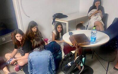 Students sitting on the shelter floor in their dorm at Tel Aviv University. May 2021. (Batya Goldberg)