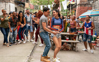 """Anthony Ramos and Melissa Barrera star in """"In the Heights,""""  a film based on Lin-Manuel Miranda's Broadway musical about the Washington Heights neighborhood of Manhattan. (© 2021 WARNER BROS. ENT.)"""