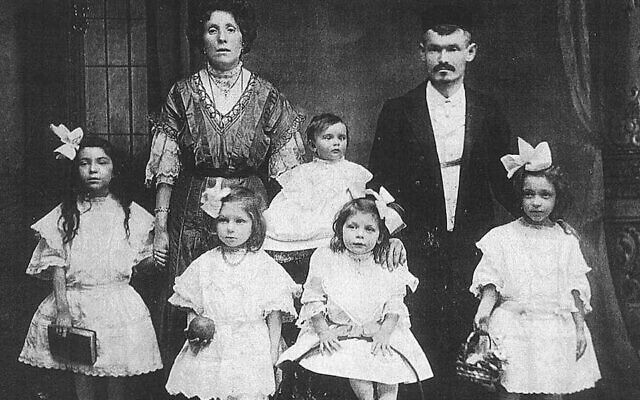 """Cilly and Morris Brenner with the five daughters who would inspire the children's book series, """"All-of-a-Kind Family,"""" 1909. Author Sydney Taylor is second from left, holding an apple. (Courtesy of Judy Magid)"""