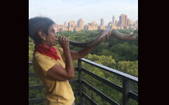 Since the early days of the pandemic, Rabbi Janise Poticha has kept up her shofar-blowing at 7 p.m. daily from her Upper West Side balcony as a salute to health care workers. (Lydia Orias)