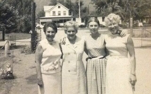"""Author Sydney Taylor, second from right, with her sisters Ella, Gertie and Henny at Camp Cejwin. Taylor based her classic """"All-of-a-Kind Family"""" children's books on the sisters' adventures growing up on the Lower East Side. (From the private collection of Jo Taylor Marshall)"""