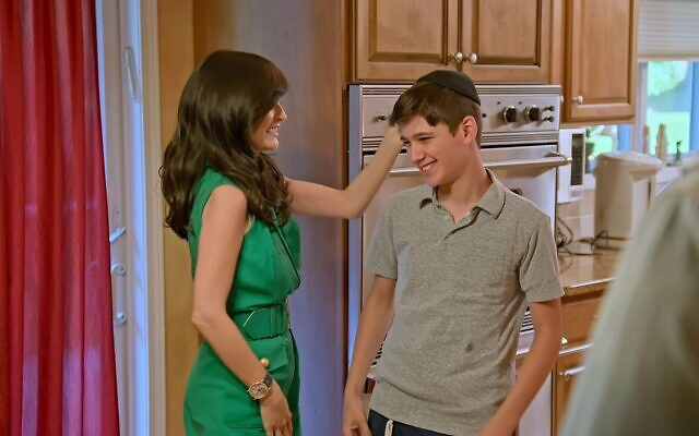"""Julia Haart and her 11-year-old son, Aron, who is still religious, in a scene from the Netflix reality show, """"My Unorthodox Life."""" (Courtesy of Netflix)"""