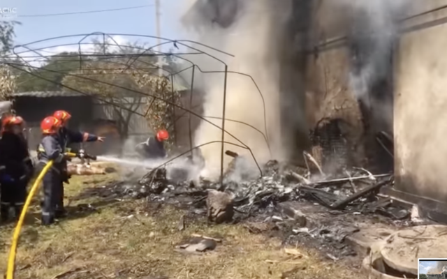 Firefighters respond at the scene of a plane crash at a house in Sheparivtsi, Ukraine on July 28, 2021. (Screenshot/YouTube)