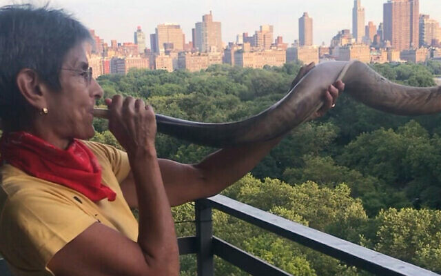 Since the early days of the pandemic, Rabbi Janise Poticha has blown a shofar every day at 7 p.m. from her Upper West Side balcony as a salute to health care workers. (Lydia Orias)