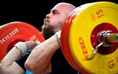 Israel's David Litvinov competes in the men's +109kg weightlifting competition during the Tokyo 2020 Olympic Games at the Tokyo International Forum in Tokyo on Aug. 4, 2021. He finished fifth. (Photo by Alexander Nemenov/AFP via Getty Images)