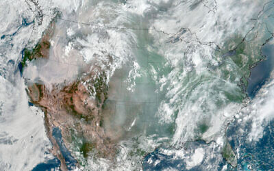 Weather satellite image of smoke, haze and clouds over most of the continental United States, Aug. 6, 2021. (Stuart Rankin/Flickr Commons)