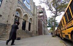 A man walks past an Orthodox yeshiva in Brooklyn, Sept. 29, 2020. (Daniel Moritz-Rabson)