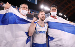 Artem Dolgopyat of Team Israel celebrates winning gold in the men's floor exercise final at the Tokyo 2020 Olympic Games, Aug. 1, 2021. (Laurence Griffiths/Getty Images)