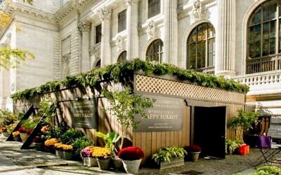 Chabad of Midtown Manhattan has constructed a sukkah in Bryant Park, behind the New York Public Library. (Chabad of Midtown Manhattan)