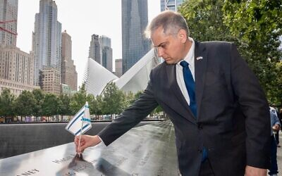 Israel Nitzan, Israel's acting consul general in New York, places an Israeli flag in memory of the victims of the Sept. 11 terrorist attacks, in a ceremony marking the tragedy's 20th anniversary on the Hebrew calendar, Aug. 31, 2021. (@IsraelinNewYork)