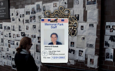 """The author's ID badge allowed her to enter a NYC morgue and sit vigil over the remains of Sept. 11 victims. In the background, a """"Wall of Peace"""" at Bellevue Hospital in Manhattan features images of those missing in the destruction of the World Trade Center by terrorists. (JTA montage by Grace Yagel. Badge courtesy Jessica Russak-Hoffman; photo by Dave Hogan/Mission Pictures/Getty Images)"""