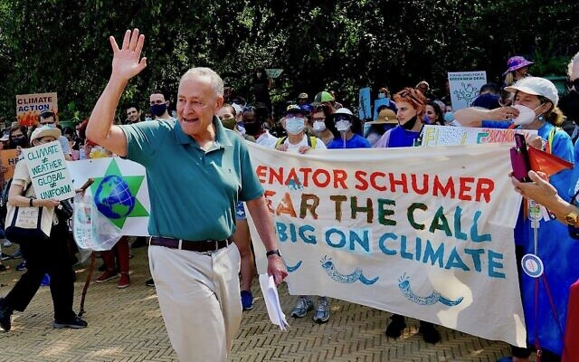 """Jews from across New York gathered in Brooklyn's Grand Army Plaza for a rally in support of """"big, bold climate action,"""" organized by Dayenu and other Jewish groups, Sept. 12, 2021. Senate Majority Leader Senator Chuck Schumer, above, vowed to press for legislation that would call for 80% clean energy by 2030 and an end to all subsidies for oil, gas, and coal. (Dayenu)"""