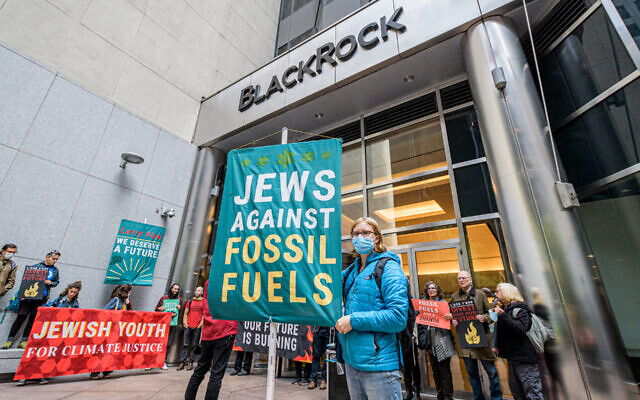 Members and supporters of the Jewish Youth Climate Movement demonstrate at the headquarters of BlackRock in Manhattan, demanding that the investment firm's CEO Larry Fink defund the fossil fuel industry, Oct. 18, 2021. (Courtesy Erik McGregor)