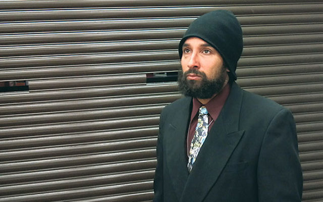 "Matthew Graham, an ""Orthodox Christian,"" wearing a wool ski cap at the time of his court hearing in 2013."