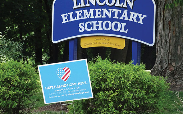 """A sign bearing the words """"Hate Has No Home Here"""" stands in front of Lincoln Elementary School in Caldwell, which was defaced by anti-Semitic graffiti in June. Photo by Robert Wiener"""