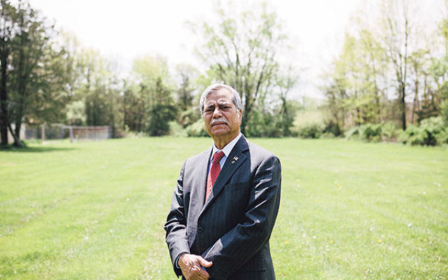 M. Ali Chaudry, president of the Islamic Society of Basking Ridge, stands on the grounds of the proposed mosque in Bernards Township.