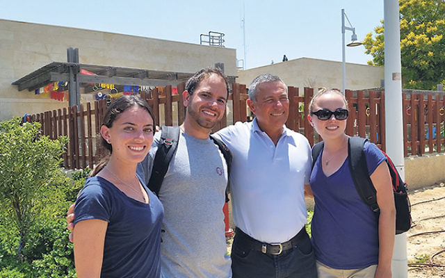 With ALEH Negev founder, retired IDF Maj. Gen. Doron Almog, second from right, are the three New Jersey residents, from left, Emily Blum, Etan Tammam, and Jess Rudin, who interned there this summer, working with severely disabled children and adults.&nbsp