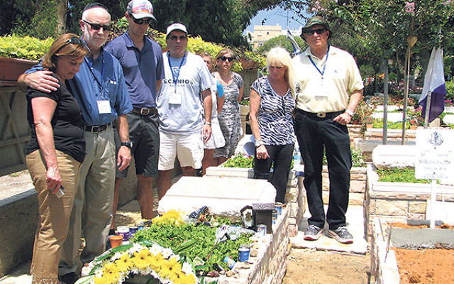 "Ken Rubenstein, center, with members of the ATS solidarity delegation participating in a memorial service in Haifa for Sgt. Nissim Sean Carmeli, a ""lone soldier"" from Texas who was killed in Gaza in July."