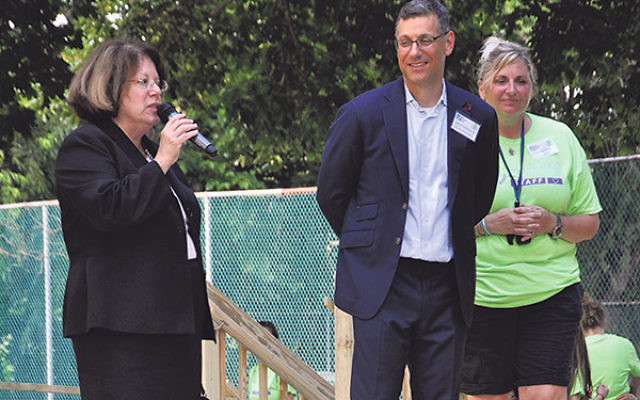 Extending a welcome to the new camp facility are, from left, NJ State Sen. Linda Greenstein, JCC president Daniel Herscovici, and JCC Abrams Camps director Wendy Soos.