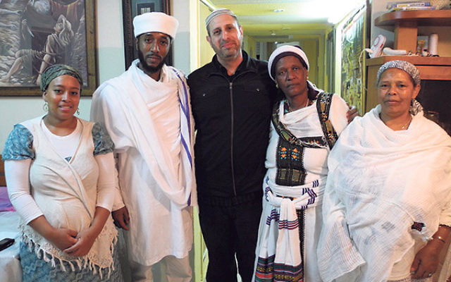 Writer and researcher Shai Afsai, center, visits with Qes Efraim Zion-Lawi, the first Israel-born Beta Israel priest, and his family in Carmiel.