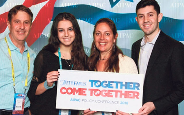Sheri Goldberg, CRC Israel and World Affairs Chair, third from left, with her children, Michael, Alexa, and Dan Smith, in front of a backdrop at the AIPAC conference.