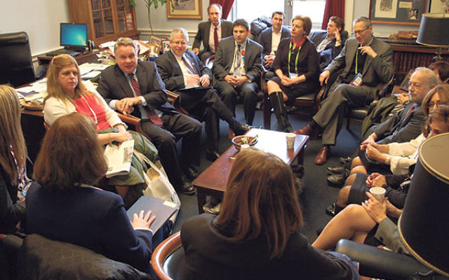 Conferring with Rep. Chris Smith (R-Dist. 4), second from left, are delegates to the AIPAC Policy Conference from the Princeton Mercer Bucks area, led by Rabbi Jay Kornsgold, third from left, in Smith's Capitol Hill office.      &nbsp