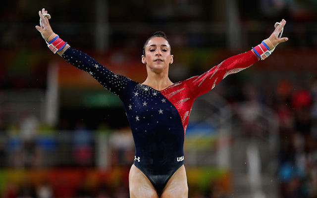 Aly Raisman competing on the uneven bars on the second day of the Rio 2016 Olympic Games at the Rio Olympic Arena, Aug. 7, 2016. (Tom Pennington/Getty Images)