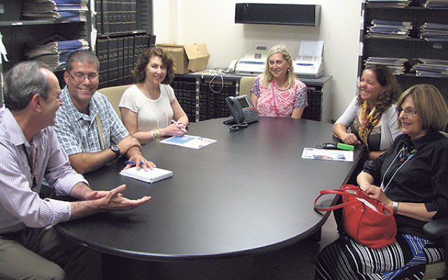 "Visitors from Arad and their local hosts visited the offices of the New Jersey Jewish News on July 6 as part of ""The Amazing Race Around Greater MetroWest."" With NJJN editor-in-chief Andrew Silow-Carroll, left, are, from left, Eyal Ke"