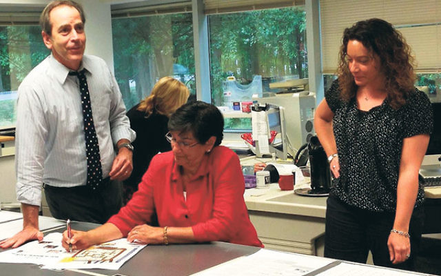Andrew Silow-Carroll, shown in the NJJN offices with managing editor Abby Meth Kanter and production editor Kristin Pena, became NJJN's editor-in-chief in 2003.
