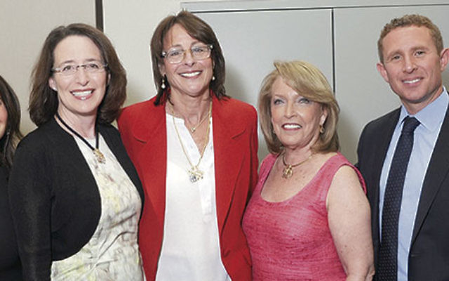 At the 2014 annual meeting of Jewish Federation of Greater MetroWest NJ are, from left, event cochair Lisa Lisser, outgoing UJA Campaign chair and incoming federation president Leslie Dannin Rosenthal, outgoing federation president Lori Klinghoffer, outgo