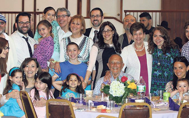Rabbi Joshua Hess and his wife Naava, center, in black dress, join congregants and family members celebrating the opening of Congregation Anshe Chesed's new mikva.