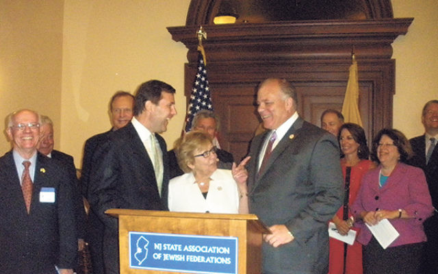 The three prime sponsors of the State Senate resolution condemning anti-Semitism are, from left, Sen. Tom Kean, Majority Leader Sen. Loretta Weinberg, and Senate President Stephen Sweeney. With them are other NJ leaders, including NJ State Association of