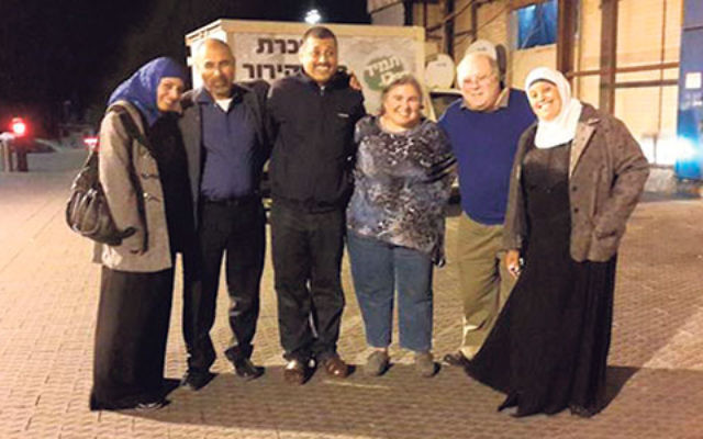 Israeli Arab Committee cochair Phyllis Bernstein, center, and Bob Kuchner, chair of the Greater MetroWest federation's Israel and Overseas Committee, second from right, visit with Bedouin educators in Jaffa last February.