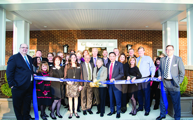 Officials at the ribbon-cutting ceremony and VIP open house event on Jan. 18.