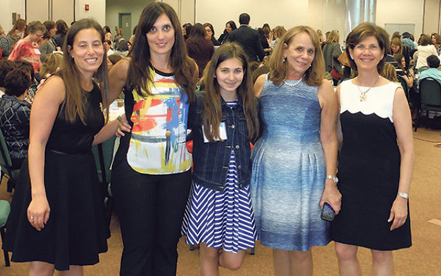 At Women's Awareness Day, author Laura Schroff, second from right, shares a moment with, from left, Danyelle Neuman of the Jewish Agency for Israel, Taryn and Mackenzie Glassman — daughter and granddaughter of the late Maxine Fischer — a
