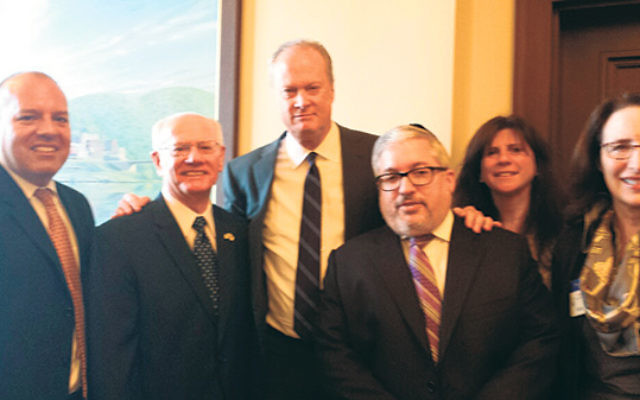 With Sen. Peter Barnes, center, are, from left, Jason Shames, CEO, Jewish Federation of Northern NJ; Jacob Toporek, executive director, NJ State Association of Jewish Federations; Josh Pruzansky, NJ director, Orthodox Union; Melanie Roth Gorelick, directo