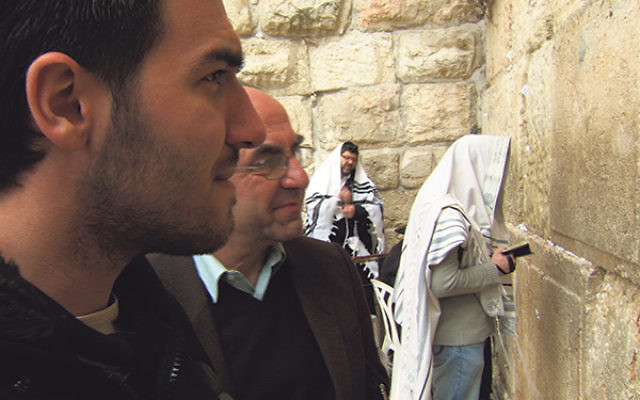 Albanians Rexhep Hoxha and his son Ermal, whose family rescued Jews during the Holocaust, visit the Western Wall, from BESA: The Promise.